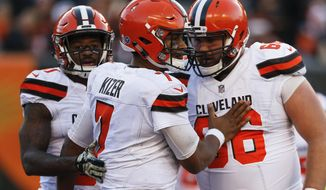 Cleveland Browns quarterback DeShone Kizer (7) celebrates with offensive tackle Spencer Drango (66) after scoring a touchdown in the second half of an NFL football game, Sunday, Nov. 26, 2017, in Cincinnati. (AP Photo/Gary Landers)
