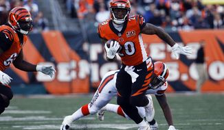 Cincinnati Bengals running back Joe Mixon (28) runs the ball past Cleveland Browns outside linebacker James Burgess in the first half of an NFL football game, Sunday, Nov. 26, 2017, in Cincinnati. (AP Photo/Frank Victores)