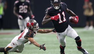 Atlanta Falcons wide receiver Julio Jones (11) runs against Tampa Bay Buccaneers cornerback Brent Grimes (24) during the second half of an NFL football game, Sunday, Nov. 26, 2017, in Atlanta. (AP Photo/John Bazemore)