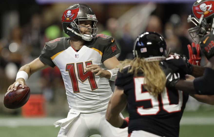 Tampa Bay Buccaneers quarterback Ryan Fitzpatrick (14) works against Atlanta Falcons defensive end Brooks Reed (50) during the first half of an NFL football game, Sunday, Nov. 26, 2017, in Atlanta. (AP Photo/Chris O'Meara)