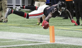 Atlanta Falcons wide receiver Julio Jones reaches to score a touchdown during the second quarter of an NFL football game against the Tampa Bay Buccaneers, Sunday, Nov. 26, 2017, in Atlanta. (Curtis Compton/Atlanta Journal-Constitution via AP)