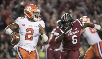 Clemson quarterback Kelly Bryant (2) scrambles from the pocket against South Carolina linebacker T.J. Brunson (6) during the first half of an NCAA college football game Saturday, Nov. 25, 2017, in Columbia, S.C. Clemson defeated South Carolina 34-10. (AP Photo/Sean Rayford) **FILE**