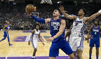 Los Angeles Clippers forward Blake Griffin, front left, goes to the basket against Sacramento Kings forward Skal Labissiere during the first quarter of an NBA basketball game Saturday, Nov. 25, 2017, in Sacramento, Calif. (AP Photo/Rich Pedroncelli)