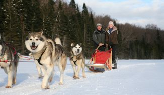 "Darley Newman rides a dogsled on an episode of ""Travels With Darley."