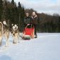 """Darley Newman rides a dogsled on an episode of """"Travels With Darley."""