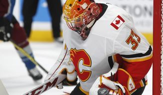 Calgary Flames goalie David Rittich makes a glove-save of a shot in the first period of an NHL hockey game against the Colorado Avalanche Saturday, Nov. 25, 2017, in Denver. (AP Photo/David Zalubowski)