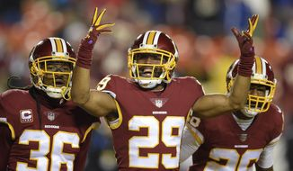 Washington Redskins cornerback Kendall Fuller (29) celebrates his game ending interception of a pass intended for New York Giants wide receiver Travis Rudolph during the second half of an NFL football game against in Landover, Md., Thursday, Nov. 23, 2017. The Redskins defeated the Giants 20-10. (AP Photo/Nick Wass)