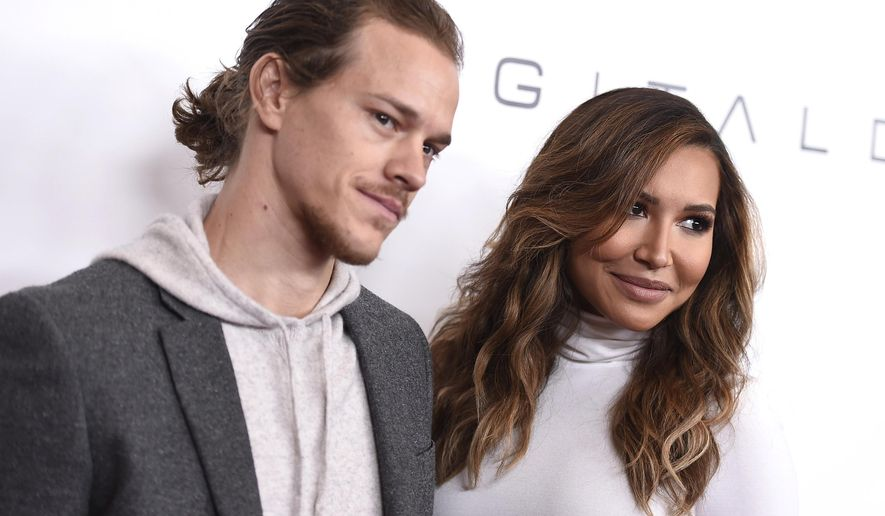 """FILE - In this Dec. 4, 2015, file photo, Ryan Dorsey, left, and Naya Rivera arrive at an event at the Beverly Wilshire hotel in Beverly Hills, Calif. Rivera, an actress on the former hit show """"Glee"""" was charged with domestic battery on her husband, Dorsey in Chesapeake, W.V., the Kanawha County Sheriff's Office tweeted Sunday, Nov. 26, 2017. (Photo by Jordan Strauss/Invision/AP, File)"""