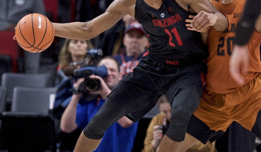 Gonzaga forward Rui Hachimura, left, posts up against Texas forward Jericho Sims during the second half of an NCAA college basketball game in the Phil Knight Invitational tournament in Portland, Ore., Sunday, Nov. 26, 2017. (AP Photo/Craig Mitchelldyer)