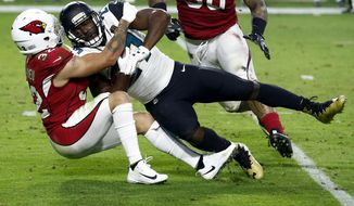 Jacksonville Jaguars running back Leonard Fournette (27) is tackled bye Arizona Cardinals free safety Tyrann Mathieu (32) during the second half of an NFL football game, Sunday, Nov. 26, 2017, in Glendale, Ariz. (AP Photo/Ross D. Franklin)