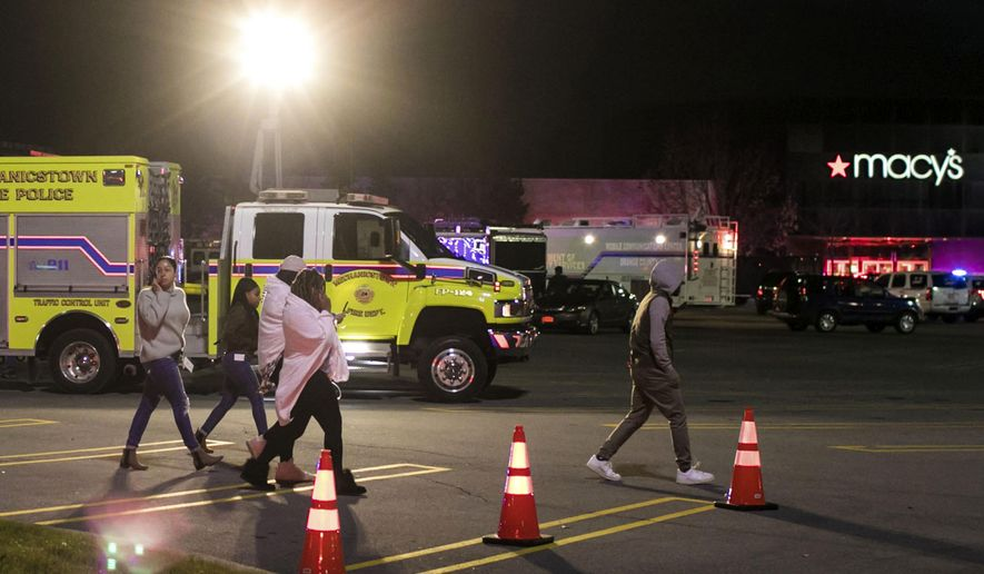People are evacuated after reports of shots fired at the Galleria at Crystal Run, Sunday, Nov. 26, 2017, in Middletown, N.Y. (Allyse Pulliam/Times Herald-Record via AP)