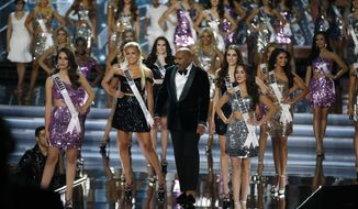 Steve Harvey, center, takes the stage at the Miss Universe pageant Sunday, Nov. 26, 2017, in Las Vegas. (AP Photo/John Locher)