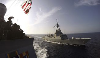 In this Oct. 5, 2016, photo released by the U.S. Navy, the Spanish Navy frigate Alvaro de Bazan, right, cruises alongside the destroyer USS Carney, left, off the coast of Rota, Spain, in the Mediterranean Sea. Bath Iron Works in Bath, Maine, said in November 2017 it is partnering with the Spanish builder of the Alvaro de Bazan on a new design for up to 20 frigates for the U.S. Navy. (Weston Jones/U.S. Navy via AP)