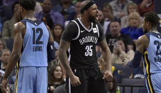 Brooklyn Nets forward Trevor Booker (35) reacts after dunking the ball in the second half of an NBA basketball game against the Memphis Grizzlies, Sunday, Nov. 26, 2017, in Memphis, Tenn. (AP Photo/Brandon Dill)