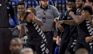 Butler forward Kelan Martin, left, reacts after making the game winning basket during overtime of an NCAA college basketball game against Ohio State in the Phil Knight Invitational tournament in Portland, Ore., Sunday, Nov. 26, 2017. (AP Photo/Craig Mitchelldyer)