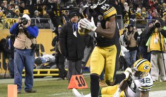 Pittsburgh Steelers wide receiver Antonio Brown (84) breaks the tackle by Green Bay Packers strong safety Morgan Burnett (42) to score on a pass from quarterback Ben Roethlisberger during the second half of an NFL football game in Pittsburgh, Sunday, Nov. 26, 2017. (AP Photo/Don Wright)
