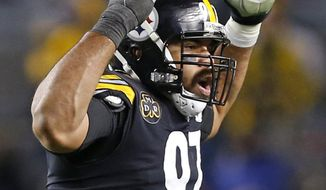 Pittsburgh Steelers defensive end Cameron Heyward (97) celebrates a missed field goal attempt by Green Bay Packers kicker Mason Crosby (2) during the second half of an NFL football game in Pittsburgh, Sunday, Nov. 26, 2017. (AP Photo/Keith Srakocic)