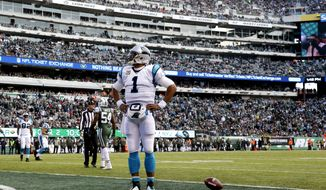 Carolina Panthers quarterback Cam Newton (1) stands in the end zone after scoring on a touchdown run against the New York Jets during the first half of an NFL football game, Sunday, Nov. 26, 2017, in East Rutherford, N.J. (AP Photo/Kathy Willens)