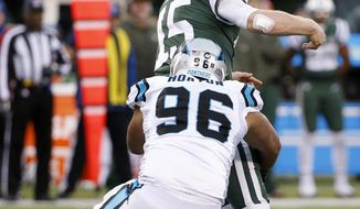 New York Jets quarterback Josh McCown (15) fumbles the ball as Carolina Panthers defensive end Wes Horton (96) applies pressure during the second half of an NFL football game, Sunday, Nov. 26, 2017, in East Rutherford, N.J. (AP Photo/Kathy Willens)