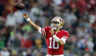 San Francisco 49ers quarterback Jimmy Garoppolo (10) throws against the Seattle Seahawks during the second half of an NFL football game Sunday, Nov. 26, 2017, in Santa Clara, Calif. (AP Photo/John Hefti) **FILE**