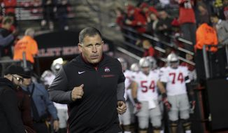 FILE- This Sept. 30, 2017 file photo shows former Rutgers football head coach, now Ohio State associate head coach/defensive coordinator Greg Schiano running onto the field before an NCAA college football game against Rutgers in Piscataway, N.J. Ohio State coach Urban Meyer says Tennessee has contacted Schiano about its head coaching vacancy. Meyer didn't have any additional details about Tennessee's potential interest in his defensive coordinator. Tennessee is seeking a new coach after firing Butch Jones two weeks ago. Schiano posted a 68-67 record as Rutgers' coach from 2001-11. (AP Photo/Mel Evans, file) **FILE**