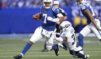 Indianapolis Colts quarterback Jacoby Brissett (7) runs past Tennessee Titans' Kevin Byard (31) during the first half of an NFL football game, Sunday, Nov. 26, 2017, in Indianapolis. (AP Photo/Michael Conroy)