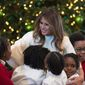 "First lady Melania Trump is greeted by children as she arrives to visits with them in the East Room among the 2017 holiday decorations with the theme ""Time-Honored Traditions"" at the White House. (Associated Press)"