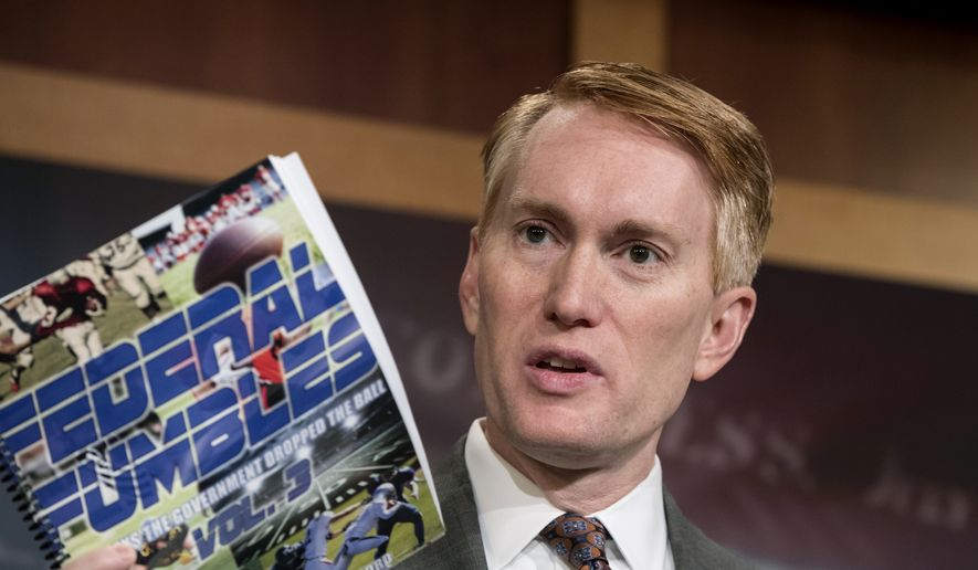 Sen. James Lankford, R-Okla., a member of the Senate Appropriations Committee, holds a news conference to outline the release of his report on wasteful spending in the federal government, on Capitol Hill in Washington, Monday, Nov. 27, 2017. (AP Photo/J. Scott Applewhite)