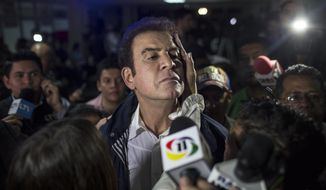Opposition Alliance presidential candidate Salvador Nasralla, center, talks to the press after a press conference in Tegucigalpa, Honduras, Monday, Nov. 27, 2017. Hondurans waited anxiously with no results released hours after polls closed for Sunday's presidential election, while both the president and his main challenger claimed victory after what appeared to be a heavy turnout by voters. (AP Photo/Rodrigo Abd)