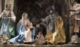 A detail of the baby Jesus is seen in a Nativity scene in the East Room during a media preview of the 2017 holiday decorations at the White House in Washington, Monday, Nov. 27, 2017. (AP Photo/Carolyn Kaster)