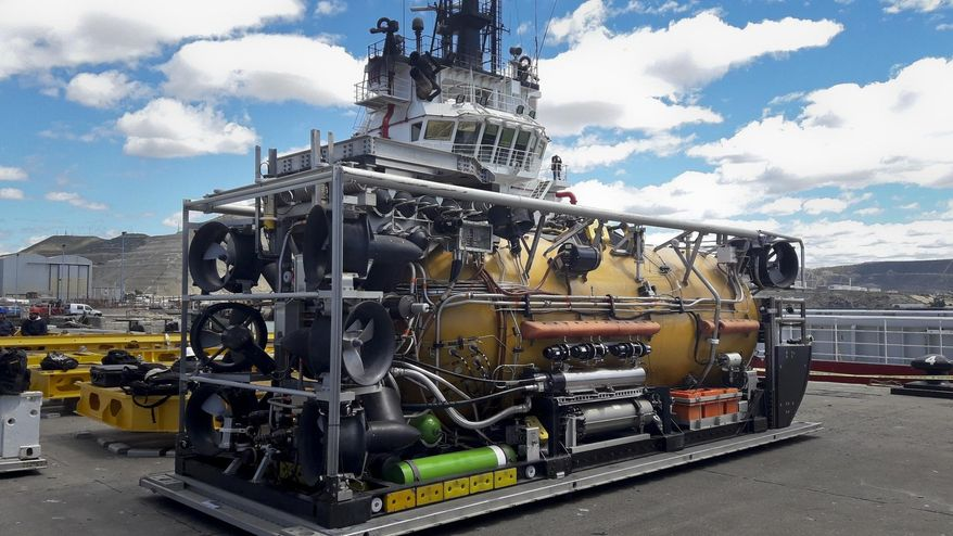 A US Navy pressurized rescue module sits on the dock before being loaded on the Sophie Siem ship in Comodoro Rivadavia port, Argentina, Wednesday, Nov. 22, 2017. Argentine families of 44 crew members aboard a submarine that has been lost in the South Atlantic for seven days are growing increasingly distressed as experts say that the crew might be reaching a critical period of low oxygen on Wednesday. (AP Photo/Saul Gherscovici)