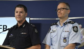 Australian Federal Police, Acting Deputy Commissioner Ian McCartney, right, and Victoria State Police Deputy Commissioner Shane Patton address the media at the Victorian Police Centre in Melbourne Tuesday, Nov. 28, 2017.  Australian police have arrested a man accused of planning a mass shooting for New Year's Eve in a crowded Melbourne square, officials said on Tuesday. (James Ross/AAP Image via AP)