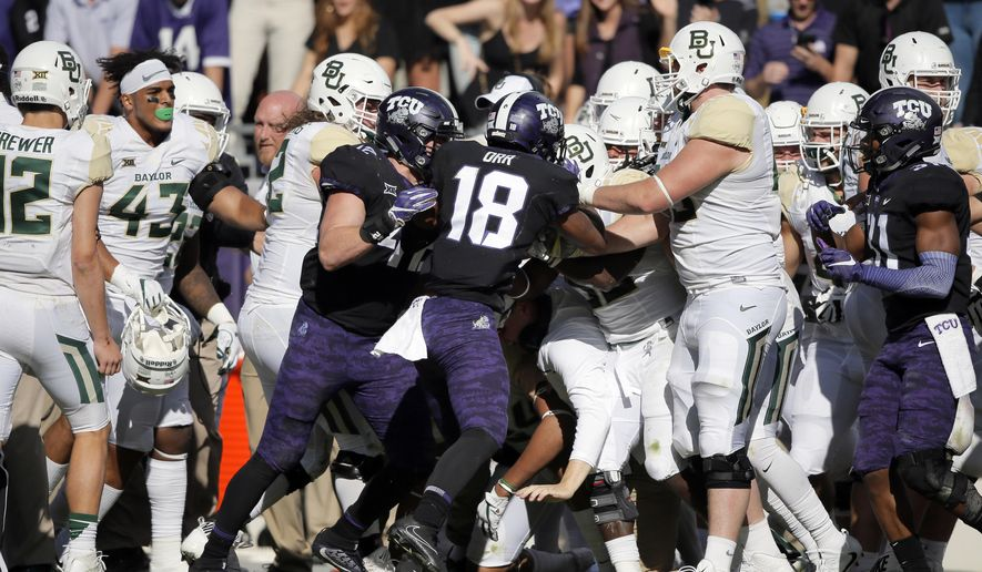 TCU safety Nick Orr (18) and Baylor's sideline erupts into a shoving match during the second half of an NCAA college football game, Friday, Nov. 24, 2017, in Fort Worth, Texas. TCU won 45-22. (AP Photo/Brandon Wade)