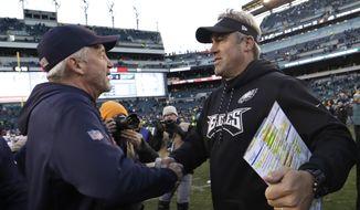 Chicago Bears head coach John Fox, left, and Philadelphia Eagles head coach Doug Pederson meet after an NFL football game, Sunday, Nov. 26, 2017, in Philadelphia. Philadelphia won 31-3. (AP Photo/Michael Perez)