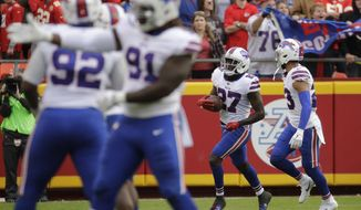 Buffalo Bills cornerback Tre'Davious White (27) celebrates with teammates after he intercepted a throw intended for Kansas City Chiefs wide receiver Tyreek Hill, during the second half of an NFL football game in Kansas City, Mo., Sunday, Nov. 26, 2017. The Buffalo Bills won 16-10. (AP Photo/Charlie Riedel)