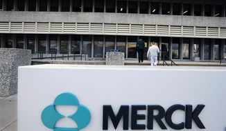 FILE - This Thursday, Dec. 18, 2014, file photograph, shows a sign at the Merck company facilities in Kenilworth, New Jersey.  Britain said Monday Nov. 27, 2017, that  two major drugs companies plan new research facilities that will bring 1,750 jobs to Britain, part of plans to boost the country's sagging productivity after Brexit. U.S. drug-maker Merck, known internationally as MSD, will open a research hub in London, creating 950 jobs, and German life sciences firm Qiagen is planning a genomics and diagnostics campus in Manchester, northwest England, creating as many as 800 skilled jobs. (AP Photo/Mel Evans, File)