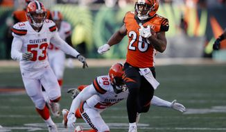 Cincinnati Bengals running back Joe Mixon (28) runs past Cleveland Browns strong safety Briean Boddy-Calhoun (20) in the first half of an NFL football game, Sunday, Nov. 26, 2017, in Cincinnati. (AP Photo/Gary Landers)