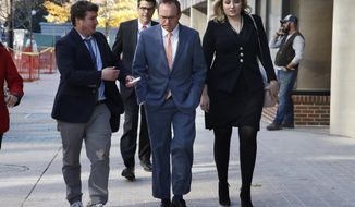 Mick Mulvaney, center, returns to the Consumer Financial Protection Bureau in Washington, Monday afternoon, Nov. 27, 2017. (AP Photo/Jacquelyn Martin)