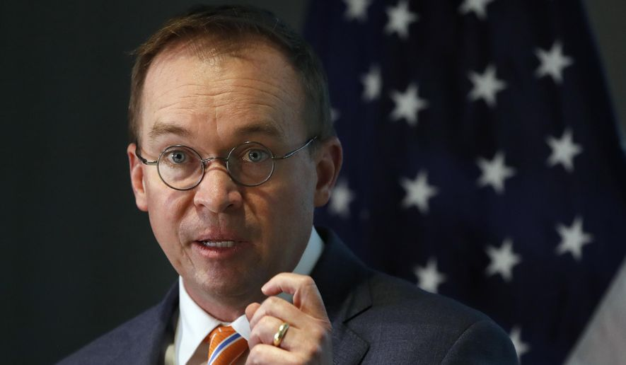 Mick Mulvaney speaks during a news conference after his first day as acting director of the Consumer Financial Protection Bureau in Washington, Monday, Nov. 27, 2017. (AP Photo/Jacquelyn Martin) ** FILE **