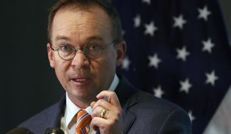 Mick Mulvaney speaks during a news conference after his first day as acting director of the Consumer Financial Protection Bureau in Washington, Monday, Nov. 27, 2017. (AP Photo/Jacquelyn Martin)