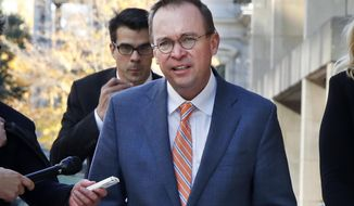 Mick Mulvaney returns to the Consumer Financial Protection Bureau in Washington, Monday afternoon, Nov. 27, 2017. (AP Photo/Jacquelyn Martin)