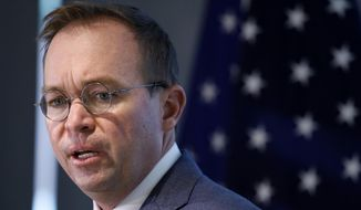 "Consumer Financial Protection Bureau acting Director Mick Mulvaney says he is sorting through files on a case-by-case basis to ""make sure that we are not going beyond the mandate, that we are not abusing our position, and that we are not getting in the way of the proper functioning of the financial services and capital markets."" (Associated Press/File)"