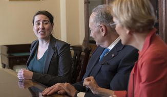 From left, Leandra English, who was elevated to interim director of the Consumer Financial Protection Bureau by its outgoing director, meets with Senate Minority Leader Chuck Schumer, D-N.Y., and Sen. Elizabeth Warren, D-Mass., to discuss the fight for control of the U.S. consumer watchdog's fate after President Donald Trump chose White House budget director Mick Mulvaney for the same post, on Capitol Hill in Washington, Monday, Nov. 27, 2017. (AP Photo/J. Scott Applewhite)