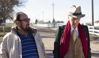 """This image released by Netflix shows Gerald Foos, a former Colorado motel owner who spied on his guests, left, celebrated writer Gay Talese in the documentary """"Voyeur,"""" by filmmakers Myles Kane and Josh Koury. (Cris Moris/Netflix via AP)"""
