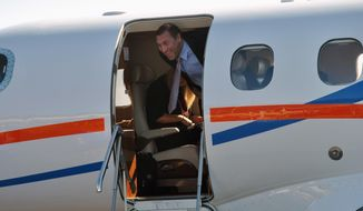University of Florida's new NCAA college football coach Dan Mullen smiles as he arrives at the airport in Gainesville, Fla., Monday, Nov. 27, 2017. (AP Photo/Mark Long)