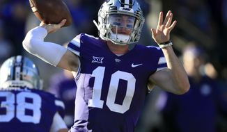 Kansas State quarterback Skylar Thompson (10) passes to a teammate during the first half of an NCAA college football game against Iowa State in Manhattan, Kan., Saturday, Nov. 25, 2017. (AP Photo/Orlin Wagner)