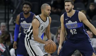 San Antonio Spurs guard Tony Parker (9) drives past Dallas Mavericks forward Maximilian Kleber (42) during the first half of an NBA basketball game, Monday, Nov. 27, 2017, in San Antonio. (AP Photo/Eric Gay)