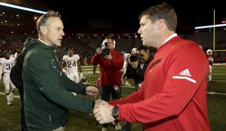 Michigan State head coach Mark Dantonio, left, shakes hands with Rutgers head coach Chris Ash after an NCAA college football game, Saturday, Nov. 25, 2017, in Piscataway, N.J. Michigan State won 40-7. (AP Photo/Julio Cortez)