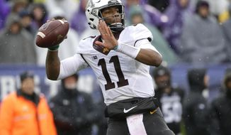 FILE - In this Nov. 18, 2017, file photo, Minnesota quarterback Demry Croft looks to pass against Northwestern during the first half of an NCAA college football game in Evanston, Ill. A school official says University of Minnesota starting quarterback Demry Croft will leave the Gophers.University spokesman Paul Rovnak texted the St. Paul Pioneer Press on Sunday night, Nov. 26, 2017, that Croft asked coach P.J. Fleck for his release after Saturday's 31-0 loss to Wisconsin. (AP Photo/Nam Y. Huh, File)