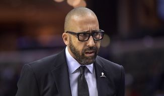 Memphis Grizzlies head coach David Fizdale stands on the court in the first half of an NBA basketball game against the Brooklyn Nets Sunday, Nov. 26, 2017, in Memphis, Tenn. (AP Photo/Brandon Dill) **FILE**